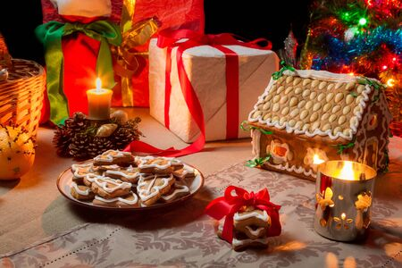 Closeup of a table set with Christmas gifts photo