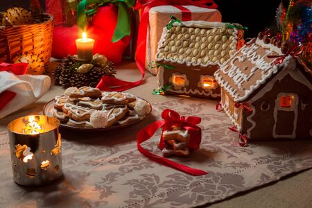 Cottages and gingerbread cookies on the Christmas table photo