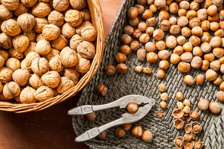 Autumn harvest of nuts in wicker baskets Stock Photo - 16397573