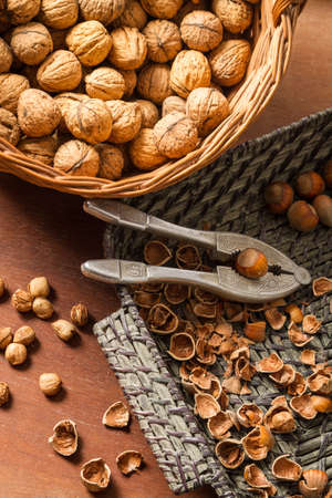 Different kinds of nuts in wicker baskets Stock Photo - 16397568