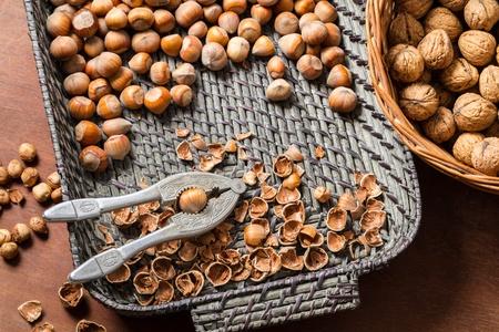 Cracking nuts hazelnuts in wicker basket Stock Photo - 16397563
