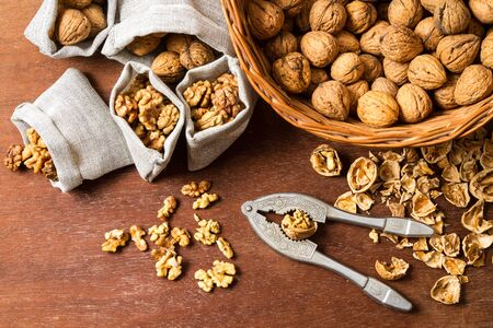 Walnut cracking and sorting them into bags Stock Photo - 16397571