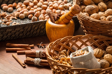 Walnuts, hazelnuts and cinnamon in wicker baskets Stock Photo - 16397558