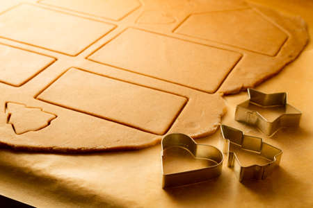 cake decorating: Close-up on gingerbread cookies cut elements Stock Photo