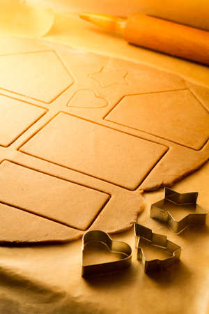 Cut different shapes of gingerbread cookies photo