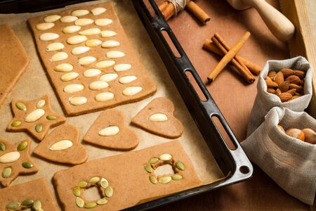 Decorating gingerbread cookies with nuts photo