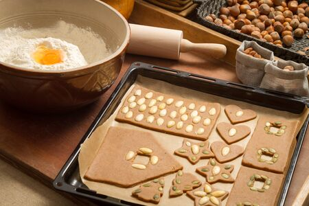 Decorating gingerbread cookies nuts just before baking Stock Photo - 16397497