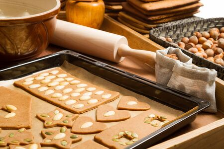Close-up of baking tray with gingerbread cookies and ingredients Stock Photo - 16397400