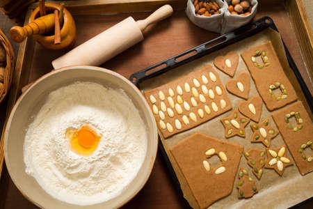 Decorating gingerbread cookies on the baking tray Stock Photo - 16397541