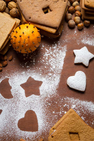 Decorating gingerbread cookies with icing sugar Stock Photo - 16397576