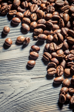 Coffee seed on wooden table background no. 2 photo