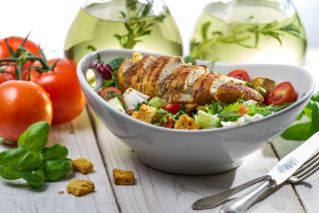 Closeup of healthy salad with chicken, tomato and olive Stock Photo - 16701812