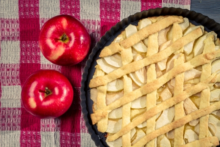 Apple pie with fruit on the table photo