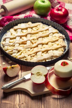 Apple pie with fresh fruits on old table photo