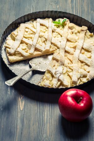 Baked apple pie on a baking tray photo