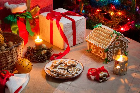 decorating christmas tree: Christmas table set with gingerbread cakes