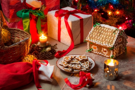 View of the Christmas table with presents and a Christmas tree Stock Photo - 16824042