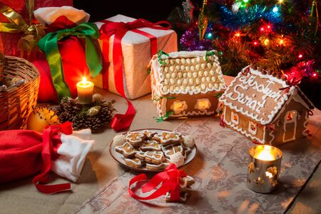 Cottages and gingerbread cookies on the Christmas table Stock Photo - 16824026