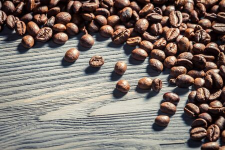 Coffee seed on wooden table background no  5 photo
