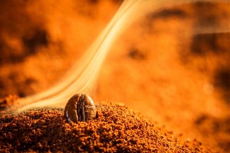 attar: Closeup one coffee beans and smoke Stock Photo
