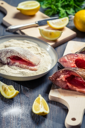 Fresh fish and ingredients for her cooking Stock Photo - 17088873