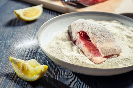 Close-up of fresh fish in flour and lemon Stock Photo - 17088846