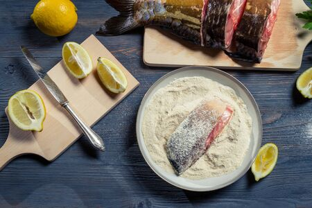 Fresh fish, flour and lemon as ingredients in a dish Stock Photo - 17089069