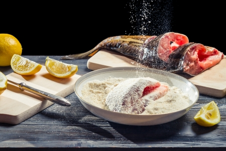 Fresh carp sprinkled with flour before frying Stock Photo - 17088764