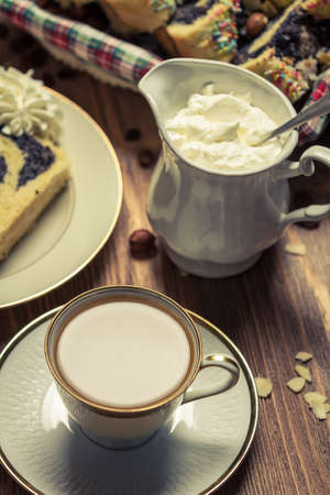 Cup of coffee, poppy seed cake and whipped cream photo