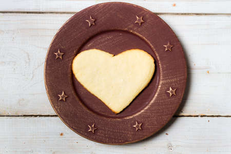 Heart-shaped cookie on a plate Stock Photo - 17127422