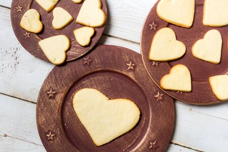 Heart-shaped cookies arranged on a plate  Stock Photo - 17127563