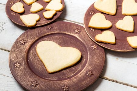 Heart-shaped cookies arranged on a plate  Stock Photo - 17127531