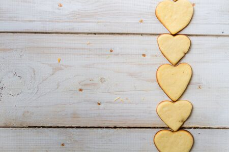 Background made with a small heart-shaped cookies Stock Photo - 17127155