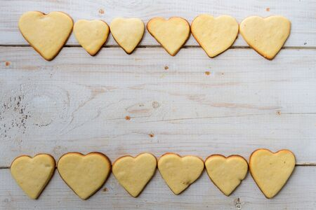Background made with a small heart-shaped cookies  Stock Photo - 17127387