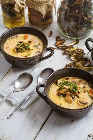 bronze bowl: Close-up of two bronze bowl of mushroom soup