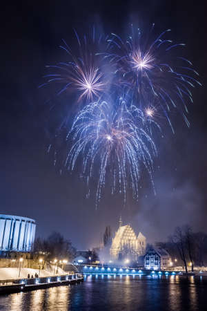 panoply: Blue fireworks over the river at night