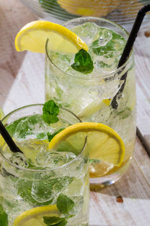 icecube: Cold lemon drink with mint leaf Stock Photo
