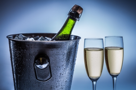 Cold chilled champagne in ice bucket photo