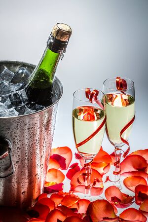 Cold champagne and red roses in the new year photo