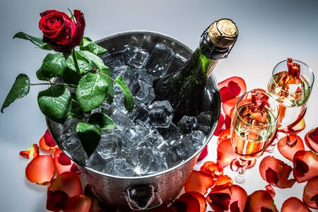 Closeup of red rose and champagne photo