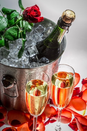 life events: Closeup of red rose and cold champagne for celebration Stock Photo