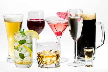 Different kinds of alcohol on a white background photo