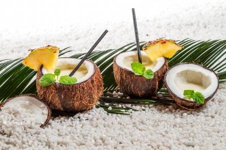 daiquiri alcohol: Pinacolada drink in coconut on beach Stock Photo