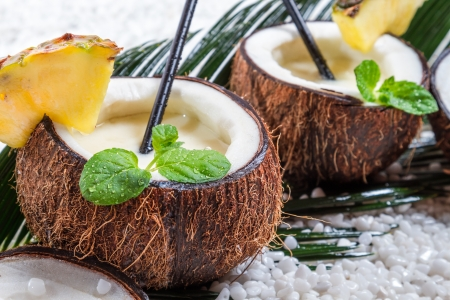 pina: Closeup of pinacolada drink in the fresh coconut Stock Photo
