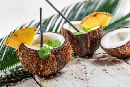 Pinacolada in the coconut with pineapple photo