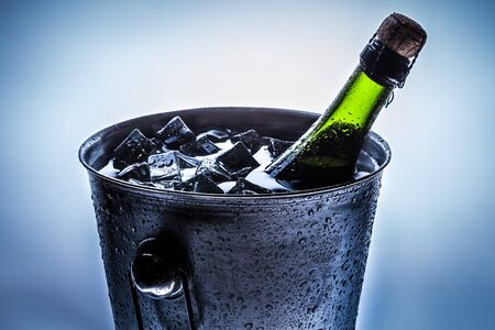 Ice cold bucket with cold champagne photo