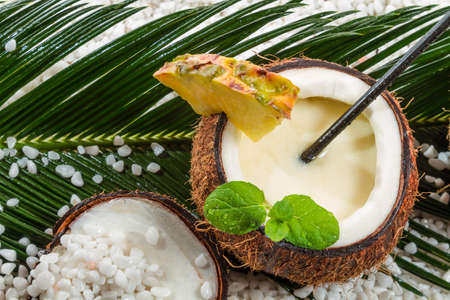caribbean drink: Pinacolada in a coconut on the beach