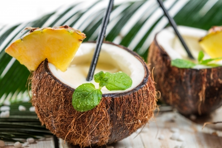 Pinacolada drink with mint served in a fresh coconut photo