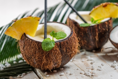 pineapple  glass: Fresh pinacolada drink served in a coconut