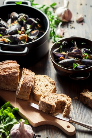 Mussels served with bread photo